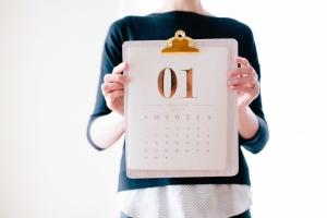 Woman holding UK outdoor marketing campaign calendar