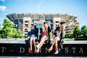 university marketing image of students celebrating graduation
